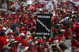 Thousands march to the Arizona Capitol for higher teacher pay and school funding in Phoenix, April 26, 2018.