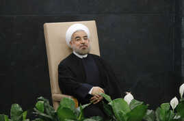 Iranian President Hassan Rouhani waits to address the 68th United Nations General Assembly, UN headquarters, New York, Sept. 24, 2013.
