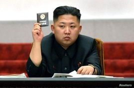 North Korean leader Kim Jong Un holds up his ballot during the fifth session of the 12th Supreme People's Assembly of North Korea at the Mansudae Assembly Hall in Pyongyang April 13, 2012.
