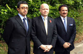 A handout picture from the Foreign and Commonwealth Office shows British Foreign Secretary William Hague (C), Emirati Foreign Minister Sheikh Abdullah bin Zayed al-Nahayan (L) and Pakistani Interior Minister Rehman Malik (R) posing for a picture duri