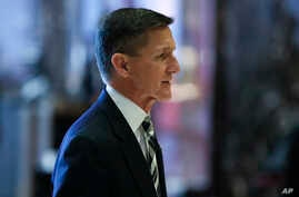 Retired Lt. Gen Michael Flynn walks through the lobby at Trump Tower, Thursday, Nov. 17, 2016, in New York. The former head of the Defense Intelligence Agency, who has been appointed as Trump's National Security Advisor, has strongly come out against
