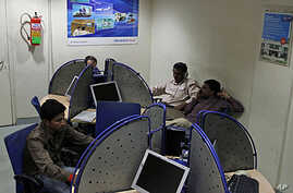 Indians surf the Internet at an Internet cafe, in Allahabad, India, April 27, 2011.