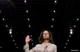 FILE - CIA director nominee and acting CIA Director Gina Haspel is sworn in to testify at her Senate Intelligence Committee confirmation hearing on Capitol Hill in Washington, May 9, 2018.