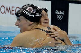 United States' Katie Ledecky, left, is congratulated by United States' Leah Smith after winning the gold medal in the women's 400-meter freestyle setting a new world record during the swimming competitions at the 2016 Summer Olympics, Sunday, Aug. 7,...