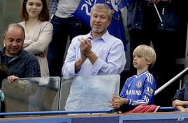 FILE - Chelsea's Russian billionaire owner Roman Abramovich applauds after Chelsea were presented with the Premier League trophy after the English Premier League soccer match between Chelsea and Sunderland at Stamford Bridge stadium in London, May 24