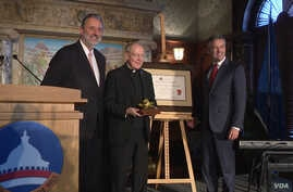 Dutch ambassador Henne Schuwer, left, with recipients of the 2017 Anne Frank Award: the Reverand Leo J. O'Donovan, center, on behalf of the Jesuit Refugee Service (JRS), and Robert Quinn, right, founding executive director of Scholars at Risk