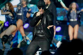 FILE - Singer Daddy Yankee performs during the Latin Billboard Awards in Coral Gables, Florida, April 28, 2016.