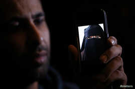 Foad, the brother of 15 year-old Nora who left her home in Avignon for Syria nine months ago, shows a portrait he took last September on his cell phone as he attends an interview with Reuters in Paris, Oct. 6, 2014.