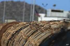 Barb wire surrounds the prison camps at the Guantanamo Bay U.S. Naval Base, Cuba in this April 17, 2013 video frame grab reviewed by the U.S. Military.