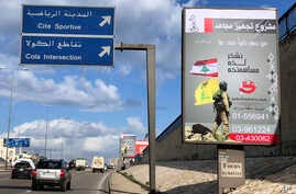 FILE - Billboards from Hezbollah's committee for the support of the Islamic resistance that shows a Hezbollah fighter while holding the group's yellow banner and Lebanon's national flag, are displayed on a highway in southern Beirut, Lebanon, Jan 19,