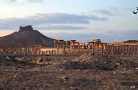 FILE - This image posted Sunday, Dec. 11, 2016, by the Aamaq News Agency, a media arm of the Islamic State group, purports to show a general view of the ancient ruins of the city of Palmyra.