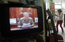 A television shows Cuba's President Raul Castro speaking during a television broadcast in Havana, Dec. 17, 2014.