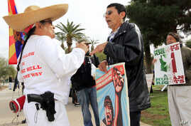 Opponents and proponents of SB1070 argue in Phoenix, Arizona.