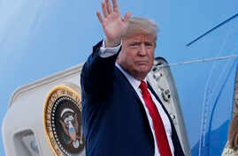 U.S. President Donald Trump waves when boarding Air Force One as he leaves from the airport in Helsinki, Finland, July 16, 2018, after the meeting with Russian President Vladimir Putin.