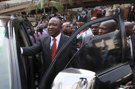 Kenya's Deputy Prime Minister Uhuru Kenyatta leaves after he was cleared by the Independent Electoral and Boundaries Commission to run for presidency in the March 4 presidential elections, in capital Nairobi, Kenya, Jan. 30, 2013.