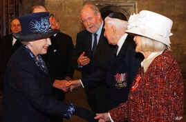 FILE - Britain's Queen Elizabeth II, left, meets Holocaust survivor Gena Turgel during a service to remember victims of the Holocaust in Westminster Central Hall in London on the 60th anniversary of the liberation of Auschwitz, Jan. 27, 2005. Turgel,