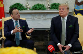 U.S. President Donald Trump listens while meeting with Ireland's Prime Minister (Taoiseach) Leo Varadkar in the Oval Office of the White House in Washington, U.S., March 14, 2018.