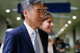 FILE - New U.S. Ambassador to the Philippines Sung Kim is escorted to the dignitaries lounge upon his arrival Dec. 1, 2016, at the Ninoy Aquino International Airport in suburban Pasay city south of Manila, Philippines.