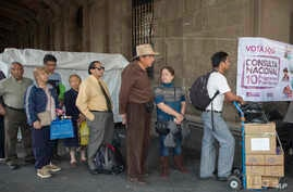 "FILE - Voters stand in line in Mexico City, Nov. 24, 2018, to cast their decision on the referendum regarding the construction of the so called ""Mayan Train,"" that would connect several cities of the Yucatan peninsula."