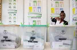 FILE - A Kenyan woman casts her vote at a mock polling station during a pre-election exhibition in Nairobi, June 12, 2017.