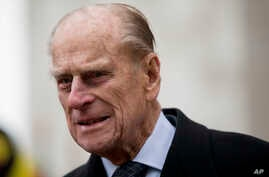 Britain's Prince Philip, the husband of Britain's Queen Elizabeth II, walks to a waiting car as he leaves after the Commonwealth Day Observance at Westminster Abbey in London, Monday, March 11, 2013.  Taking place annually on the second Monday in Mar