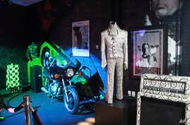 FILE - A Prince costume and motorcycle are on display at Prince's Paisley Park in Chanhassen, Minnesota,Nov. 2, 2016.