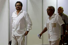 FILE - Ivan Marquez, chief negotiator for the Revolutionary Armed Forces of Colombia, or FARC, left, is seen arriving for a new round of peace talks with Colombia's government in Havana, Cuba, June 17, 2015.