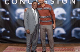 "FILE - In this Dec. 14, 2015, file photo, Dr. Bennet Omalu, left, and actor Will Smith pose together at the cast photo call for the film ""Concussion"" at The Crosby Street Hotel in New York. The movie releases in U.S. theaters on Dec. 25, 2015."