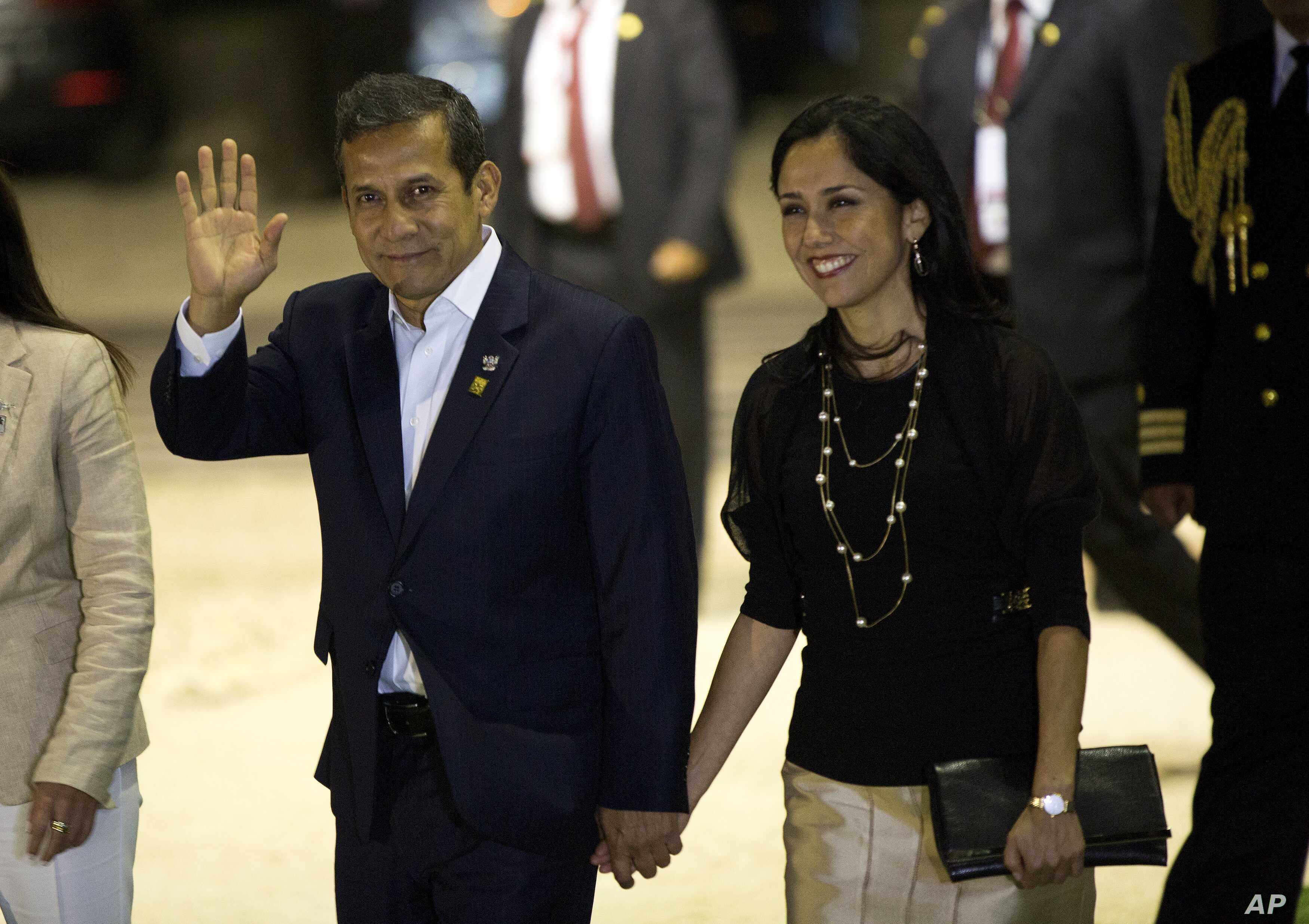 FILE - In this July 2, 2015, file photo, Peru's President Ollanta Humala waves to the press while arriving with his wife, Nadine Heredia, to the closing ceremony of a business summit in Paracas, Peru.