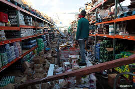 A man stands inside a supermarket destroyed by Hurricane Maria in Salinas, Puerto Rico, Sept. 29, 2017