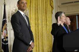 President Barack Obama listens as Homeland Security Secretary Janet Napolitano delivers the oath of allegiance during a naturalization ceremony for active duty service members and civilians, in the East Room of the White House in Washington, March 2