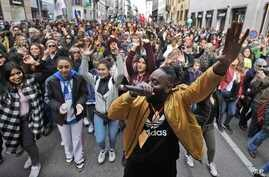 DJ Simon Samaki Osagie, with throngs of protesters behind him, sings during an anti-racism rally, in Milan, Italy, March 2, 2019