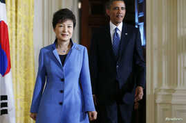 U.S. President Barack Obama and South Korea's President Park Geun-hye arrive for a joint news conference in the East Room of the White House in Washington, May 7, 2013.