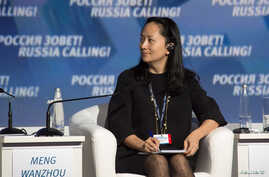 "FILE - Meng Wanzhou, executive board director of the Chinese technology giant Huawei, attends a session of the VTB Capital Investment Forum ""Russia Calling!"" in Moscow, Russia Oct. 2, 2014."
