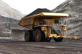 FILE - A mining truck hauls coal at Cloud Peak Energy's Spring Creek strip mine near Decker, Mont. The Northern Cheyenne Tribe challenged the Trump administration decision to life a moratorium on coal leases. The neighboring Crow tribe supports the d...