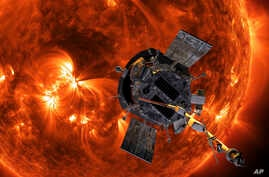 This image made available by NASA shows an artist's rendering of the Parker Solar Probe approaching the Sun.
