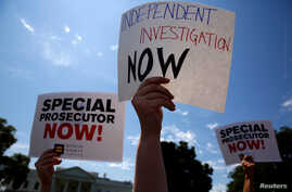 Protesters gather to rally against U.S. President Donald Trump's firing of Federal Bureau of Investigation (FBI) Director James Comey, outside the White House in Washington, U.S. May 10, 2017.