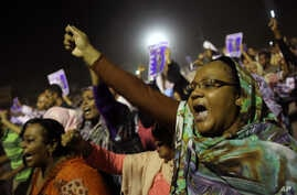 Sudanese anti-government protesters chant slogans during a demonstration in Khartoum, Sudan, Sunday, Sept. 29, 2013. Thousands of Sudanese protesters took to the streets in night march in the capital Khartoum late Sunday. (AP Photo/Khalil Hamra)
