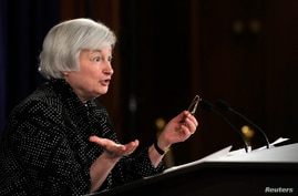 Federal Reserve Chair Janet Yellen speaks during a news conference at the Federal Reserve in Washington, June 18, 2014.