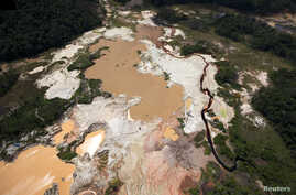 An aerial view of the environmental damage caused by illegal mining at the Canaima National Park in southern Bolivar State June 17, 2010. Venezuela's army has evicted thousands from makeshift towns in one of the world's most pristine jungles, where w