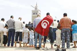 People attend Friday prayers during a demonstration in support of the ruling party Ennahda, in Tunis August 31, 2012.