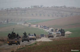Members of al Qaeda's Nusra Front drive in a convoy as they tour villages