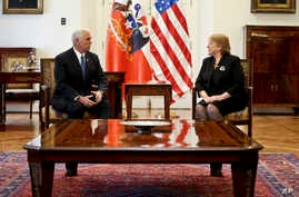 U.S. Vice President Mike Pence, right, chats with Chile's President Michelle Bachelet during a meeting at La Moneda government palace in Santiago, Chile, Aug. 16, 2017.