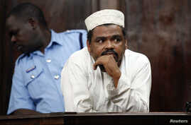 Aboud Rogo Mohammed stands inside the dock at a Law Court in  Nairobi, December 22, 2010.