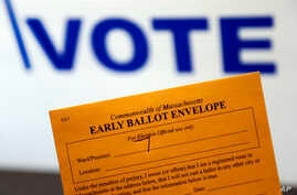 Campaign 2016 Early Voting: In this Oct. 24, 2016, photo, an early ballot envelope is held at town hall in North Andover, Mass. The millions of votes that have been cast already in the U.S. presidential election point to an advantage for Hillary Clin