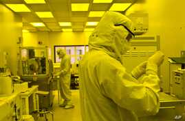 Researchers work in a clean room at the expanded University of Michigan Lurie Nanofabrication Facility in Ann Arbor, Michigan, April 10, 2008 (file photo).