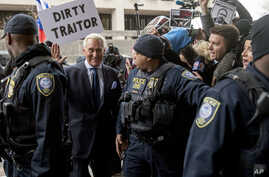 Former campaign adviser for President Donald Trump, Roger Stone arrives at Federal Court, Jan. 29, 2019, in Washington.