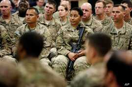 Soldiers listen to U.S. Defense Secretary Ash Carter at Kandahar Airfield in Afghanistan, Feb. 22, 2015.