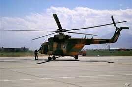 FILE - This May 13, 2013 file photo shows a Mi-17 helicopter, used by the Afghan Air Force sitting on Bagram Air Field in Afghanistan. (AP Photo/Kristin M. Hall, File)