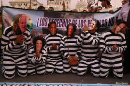 Demonstrators dressed as Peruvian politicians in prisoner clothing protest against engineering group Odebrecht in Lima, Peru, Jan. 19, 2017.